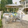 5702-32156 Daytona Seven Piece 48 Inch Round Outdoor Dining Table, with Two Sling Arm Chairs, Two Swivel Rocking Chairs Umbrella and Base