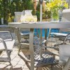 5702-30156 Daytona Seven Piece 42 Inch Round Outdoor Dining Table with Two Sling Arm Chairs, Two Swivel Rocking Chairs, Umbrella and Base