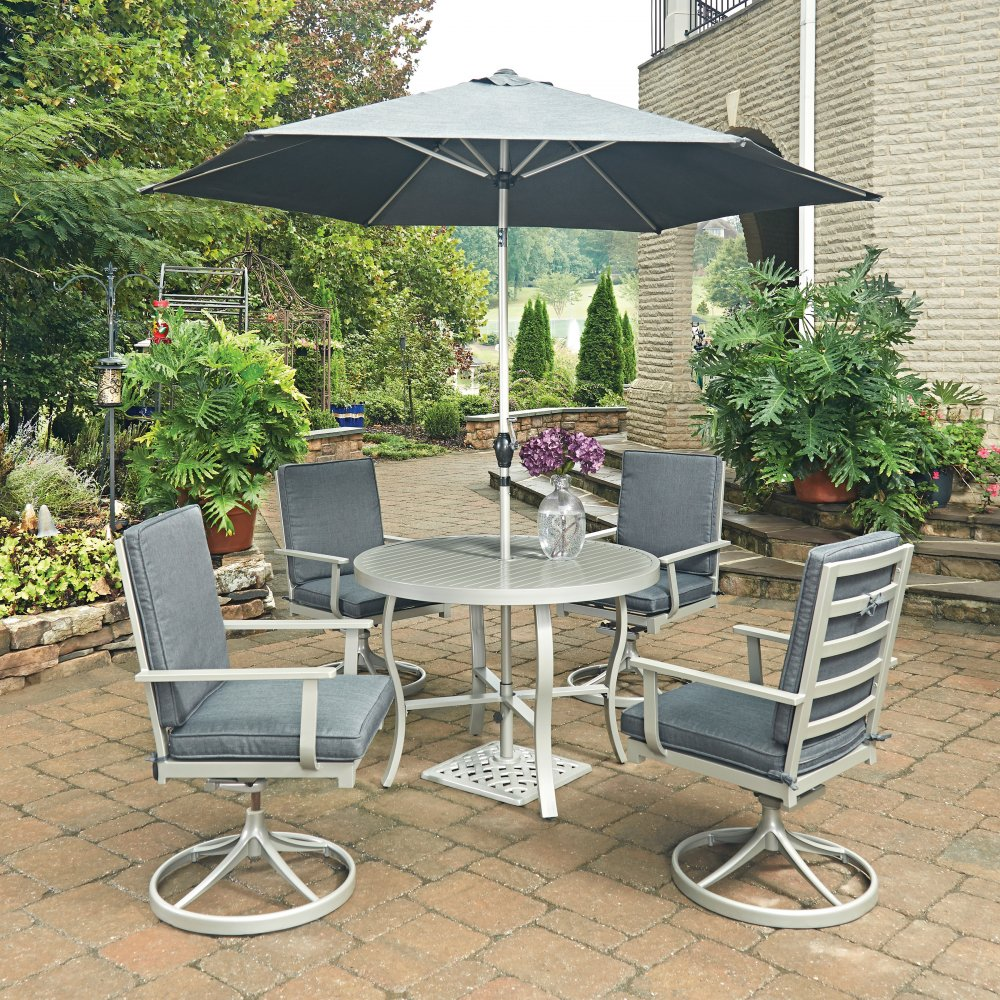 south beach 7 pc round outdoor dining table 4 swivel rocking chairs